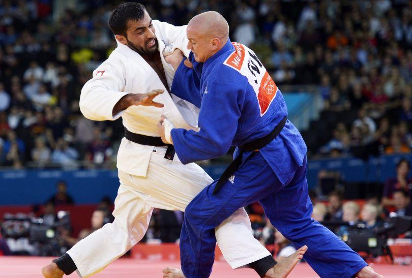 Grek Ilias Iliadis pokonał Słowaka Milana Randla w walce w kategorii 90 kg (fot. PAP/EPA)