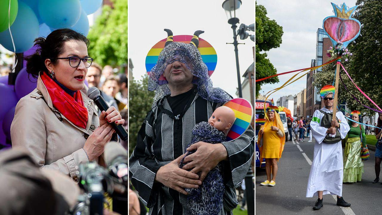 Środowiska LGBT niosły m.in. planszę, na której rysunek waginy zastąpił Najświętszy Sakrament (fot. Mateusz Slodkowski/SOPA Images/LightRocket/Getty Images)